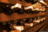 photo of wine bottles in cellar